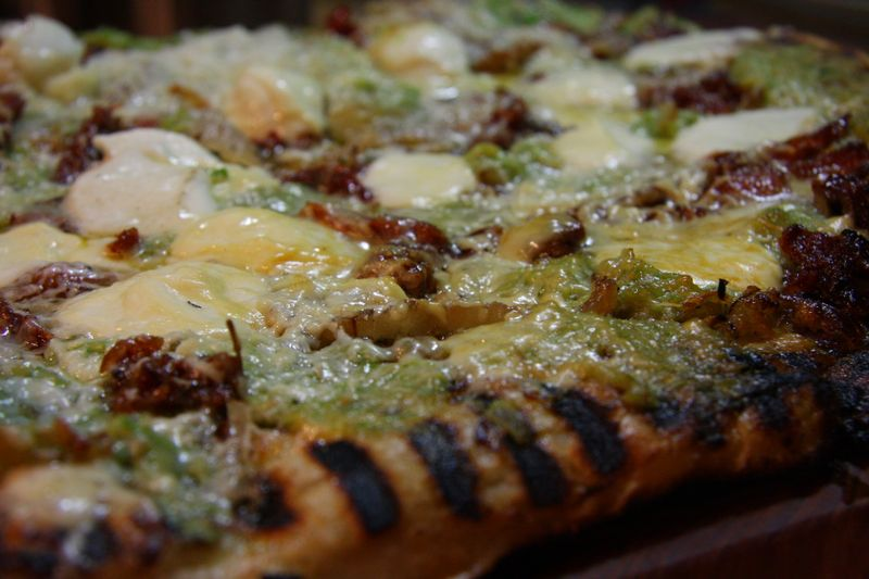 Grilled garlic scape pesto pizza